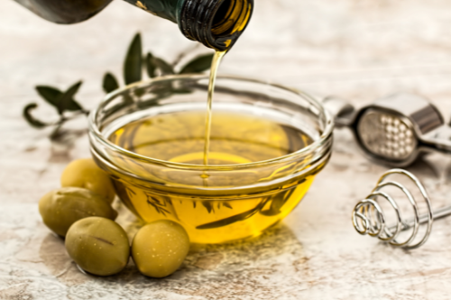 pouring out olive oil